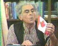 The Professor blows on a Canada flag.