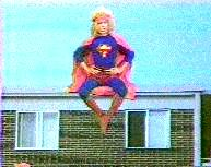 Superhippy sitting on a building.